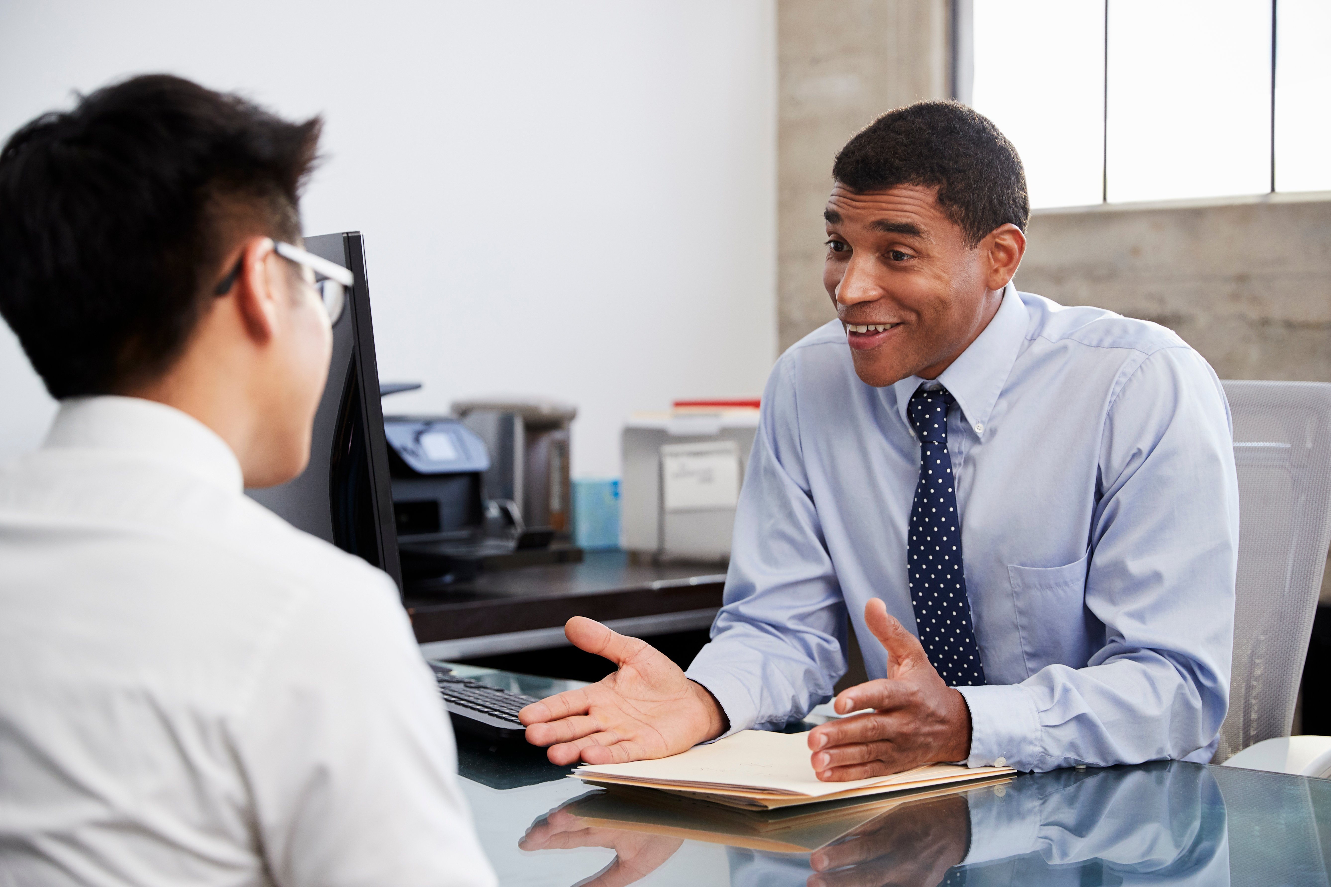 mixed-race-male-professional-in-meeting-with-young-G9HNBQE